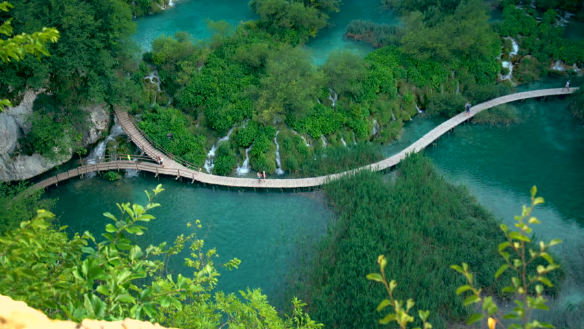 Beautiful board walk on waterfall cascade of Plitvice Lakes in Croatia. Nature landscape of Plitvice Lakes National Park is the UNESCO World Heritage in natural mountain Karst area of central Croatia.