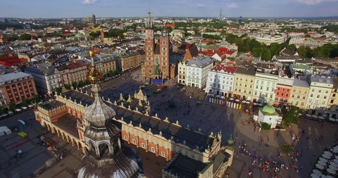 Cracow Main Squere. Camera is going down along the city hall tower. Medival old town in Europe. Drone footage shoot in 4K.