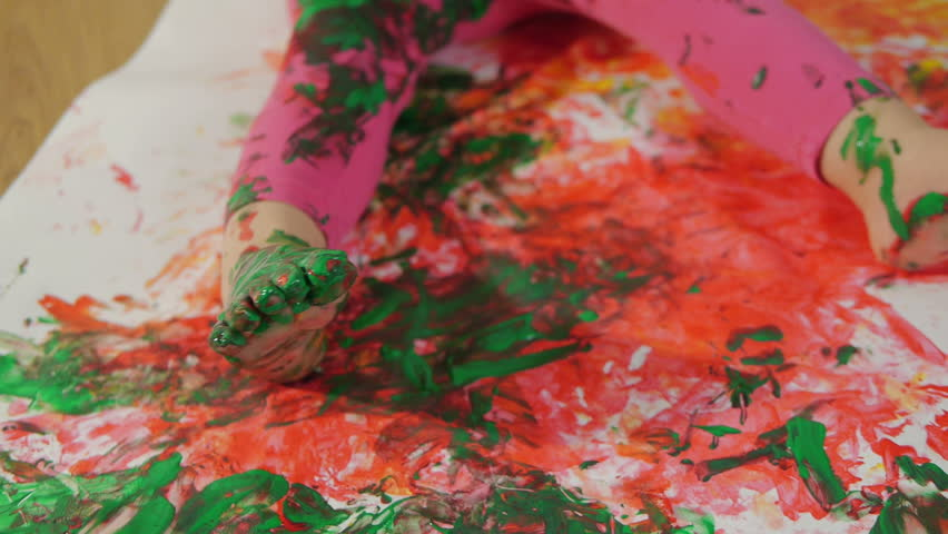 Closeup of a little girl, dirty in multicolored paints. The child learns to draw with finger paints   Shutterstock HD Video #1007482804