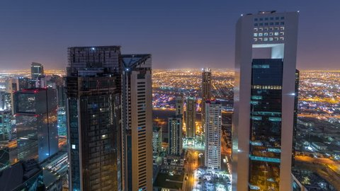 The skyline of the West Bay area from top in Doha timelapse, Qatar. Illuminated modern skyscrapers aerial view from rooftop at night before sunrise