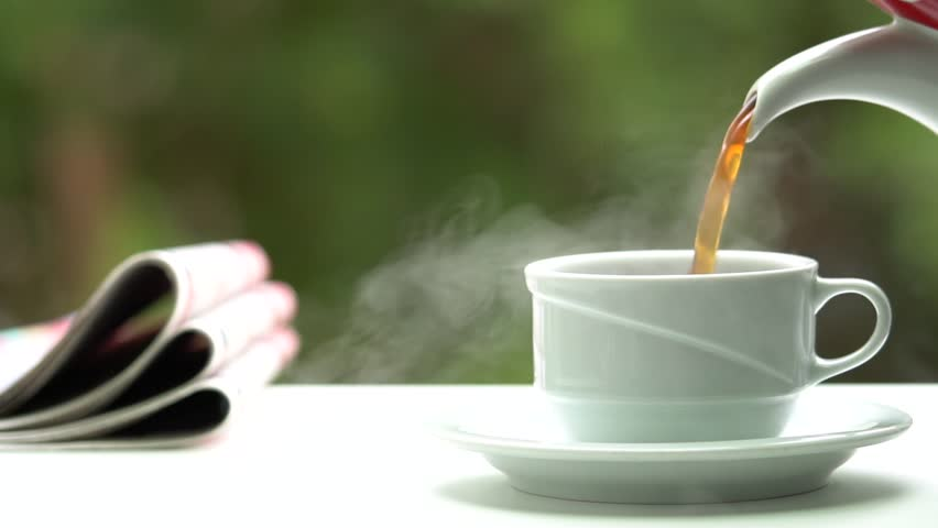Hot coffee and reading newspapers in morning sunlight | Shutterstock HD Video #1007562874