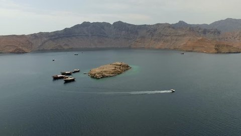 Khasab Fjords, Oman ( aerial footage ) Khasab  is a city in the exclave of Oman northwest of Muscat. It is the capital city of the Musandam peninsula on the coast of the Hormuz Straight.