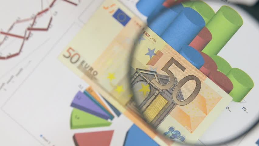 Rotating fifty euros and increase with a magnifying glass. | Shutterstock HD Video #1007578654