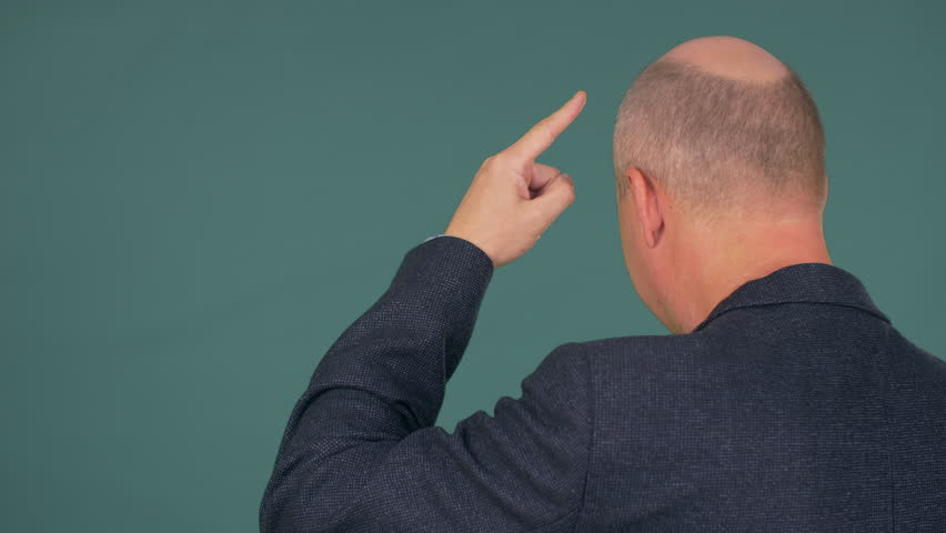 Bald businessman thinking and pointing on his head | Shutterstock HD Video #1007587993