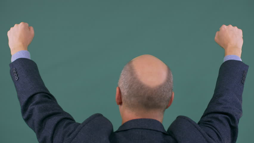 Bald businessman in suit protesting with fists up. Man rise hands up. | Shutterstock HD Video #1007601820