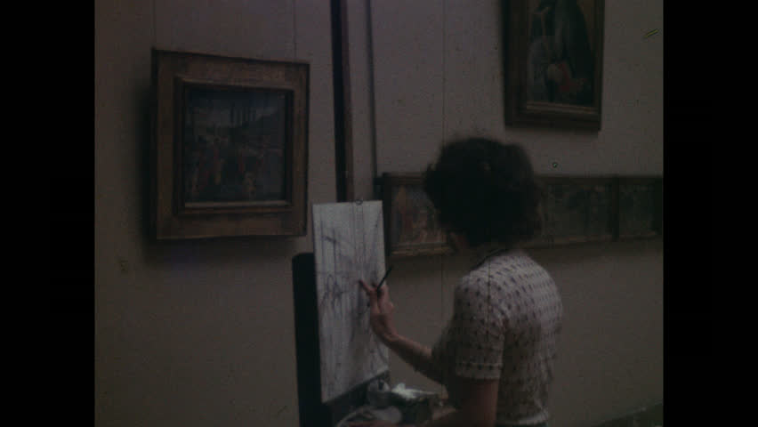 PARIS, 1970, Archival, The Louvre art museum, interior, young woman sketching on an easel   Shutterstock HD Video #1007620960