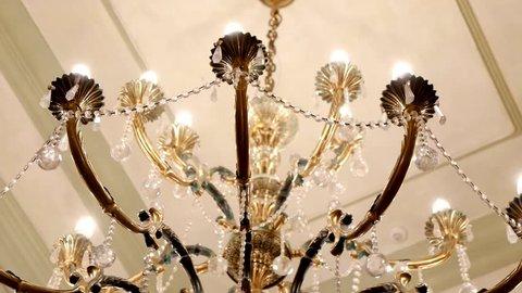 Elegant luxury chandelier. Chrystal chandelier. Crystal chandelier on the ceiling of a luxury restaurant