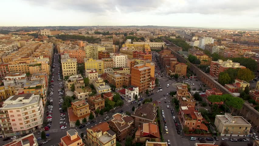 Aerial drone shot descending into the streets of Rome at sunset | Shutterstock HD Video #1007658544