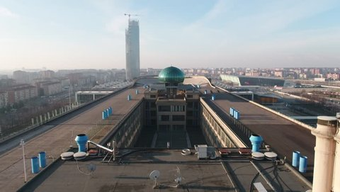 Aerial drone footage view of Lingotto overhead track in Torino Piemonte Italy sunset // no video editing