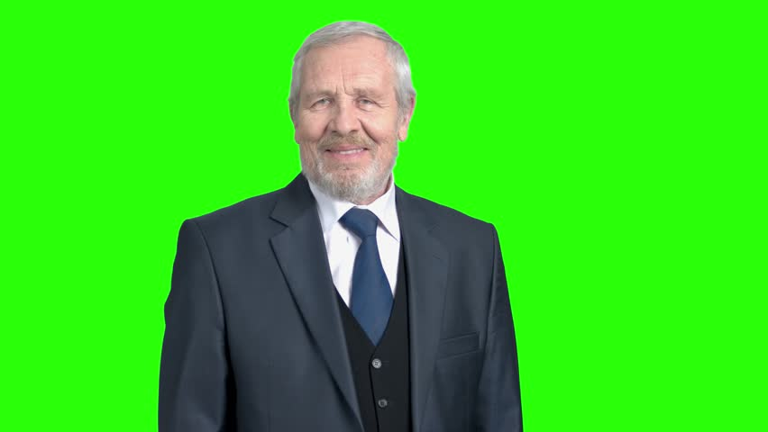 Elderly businessman giving thumb up. Old man in formal wear showing thumb up gesture on chroma key background. Symbol of agreement and success.