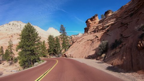 ST GEORGE, UTAH - 10 FEB: Zions National Park driving POV. Southwestern desert Utah near St George. Geological landscape wind, weather and water carved spectacular beautiful mountain valley.