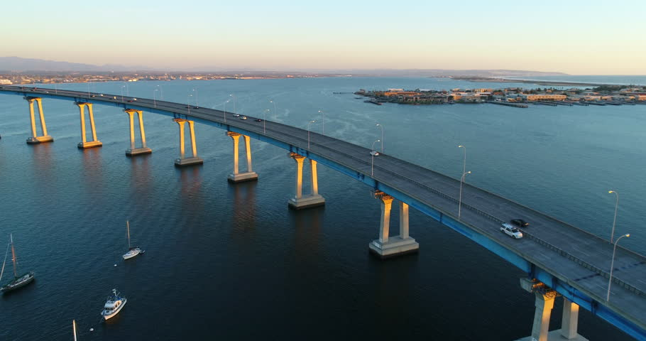Aerial Drone video flying over the Coronado Bridge with a view of the San Diego Bay During Sunset.   | Shutterstock HD Video #1007696404