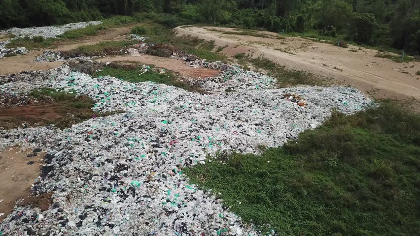 Landfill. Environmental pollution problem. Plastic bags and bottles dumped ruining natural environment.