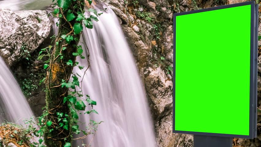 Billboard green screen near the Fabulous waterfall   Shutterstock HD Video #1007703955