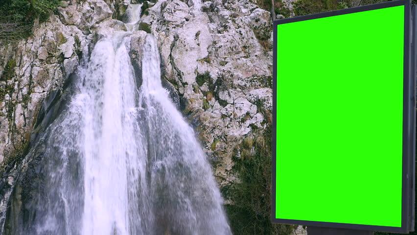 Billboard green screen near the Fabulous waterfall   Shutterstock HD Video #1007704021