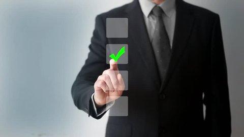 Businessman using whiteboard and touching checkbox