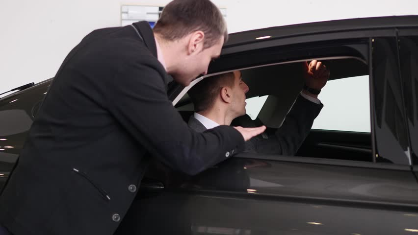 Buyer having conversation with car seller during inspecting the car   Shutterstock HD Video #1007713822