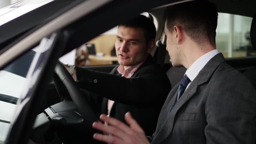 Buyer having conversation with car seller during inspecting the car   Shutterstock HD Video #1007713855