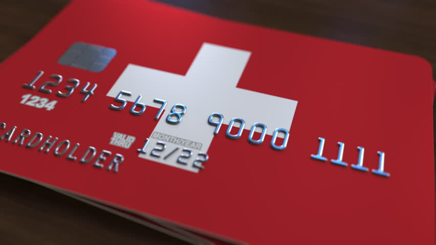 Plastic bank card featuring flag of Switzerland. National banking system related animation   Shutterstock HD Video #1007726494