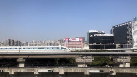 February 12, 2018, in Shanghai, China, is moving in the maglev train,4k
