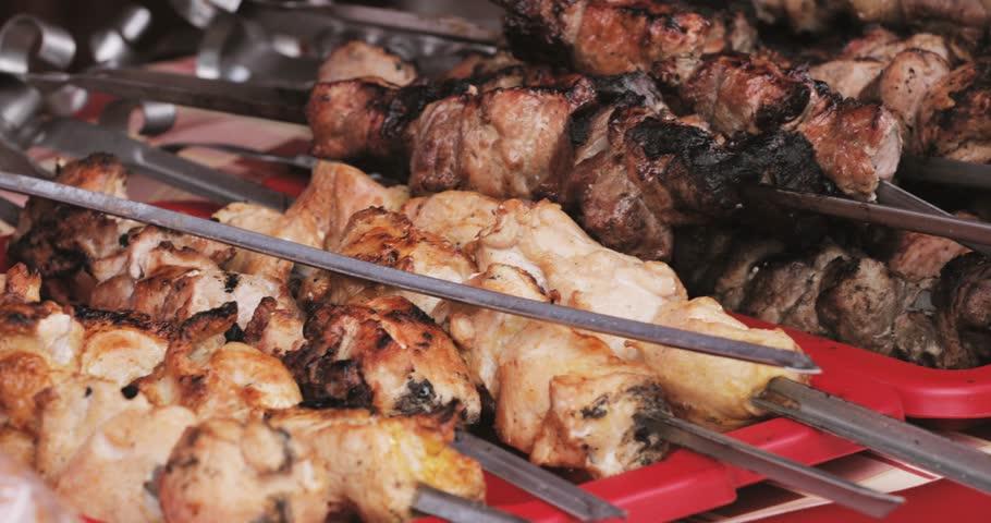Grilled Marinated Caucasus Barbecue Meat Shashlik Shish Kebab Pork Meat Grilling On Metal Skewer. Nobody. Street Food
