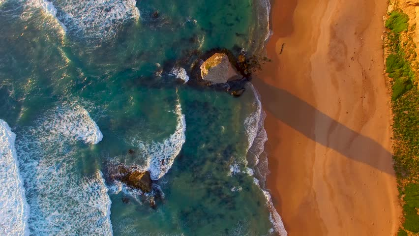 The Twelve Apostles at sunset in Port Campbell, overhead aerial view.