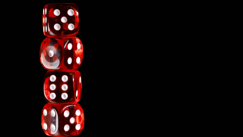 rotating red dice around its axis, on a black background
