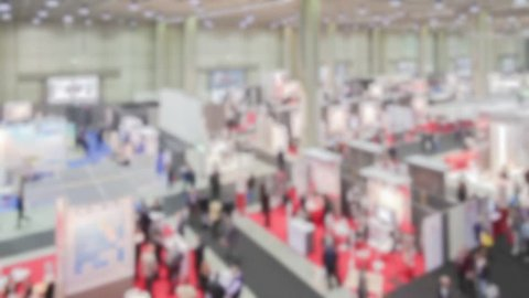 Trade show, panoramic view. Background with an intentional blur effect applied.