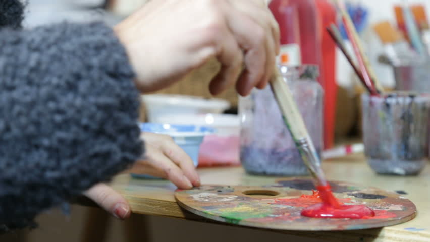Artist Painting - Red Color Poured On The Palette
