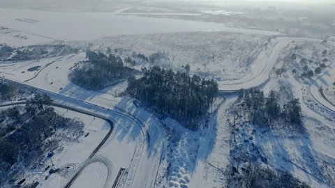 Cars driving on the winter track on autodrome circuit aerial video