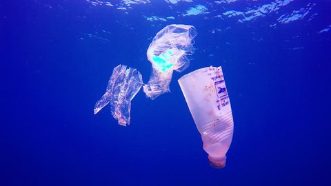 KHAO LAK, THAILAND - 25 FEBRUARY 2018: Plastic bottles and bags pollution in the ocean.