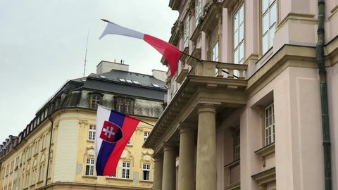 Flags of Slovakia and Bratislava waving in the wind on the building of City Hall in Bratislava, Slovakia