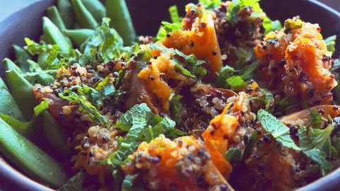 Colourful vegan quinoa salad - taking a bite with a fork