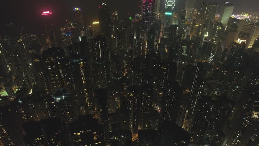 Hong Kong City Residential Tall Buildings at Night. Aerial Vertical Top-Down View. Drone is Flying Forward. Establishing Shot.