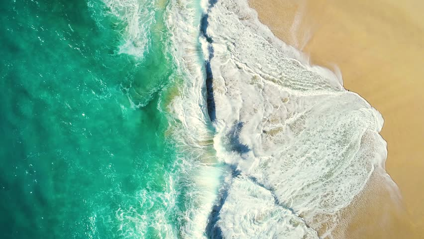 Aerial view waves break on white sand beach. Sea waves on the beautiful beach. drone 4k shot. zoom out | Shutterstock HD Video #1008056794
