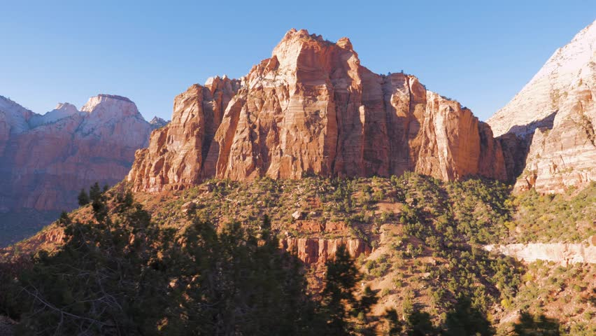 Shot camera movement, view from the car. Moving on a high mountain pass offering amazing nature views of the red rocks of the canyon. At Zion National Park, Utah, USA. Slow motion, 3840x2160, 4K. | Shutterstock HD Video #1008060574