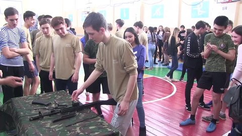 City of Yasny, Orenburg region, Russia, Komarovskaya school, 02.26.2018 Assembly and disassembly of weapons. Lesson of military training, classes with a Kalashnikov assault rifle.