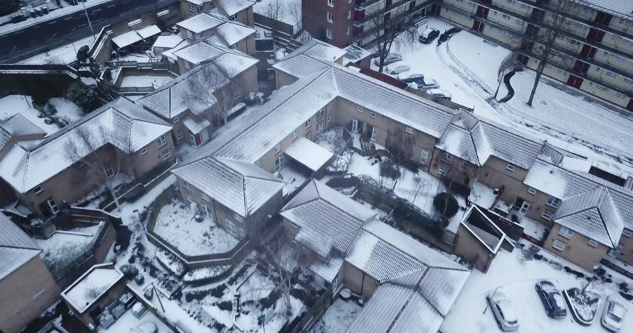Top down drone footage of a road in South West London, England, UK during a rare snow storm in March 2018. | Shutterstock HD Video #1008132604