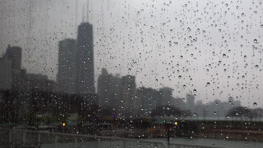Chicago in rain from Navy Pier through glass.