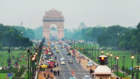 Delhi, India. Time-lapse of Car and people traffic to the India Gate in Delhi in the evening. Zoom in