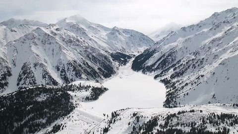 Winter aerial view of the Big Almaty lake and mountains