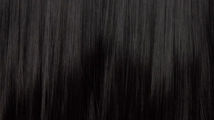 Hair texture background, no person. Black shiny hair moving slowy