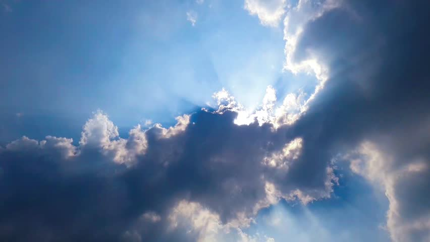 time lapse Beautiful Cloudscape with large, building clouds and sunrise breaking through cloud mass. #1008187324