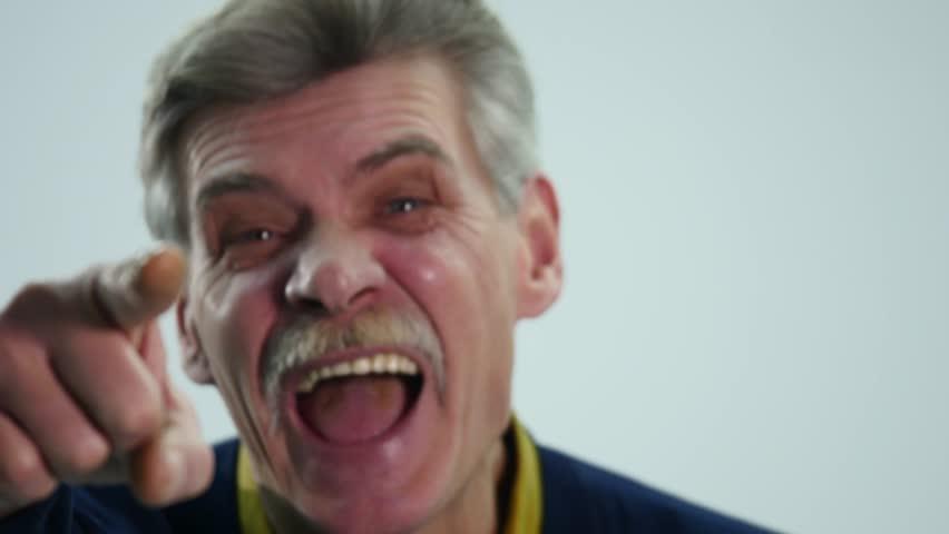 Portrait of elderly man laughing