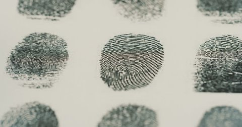 Macro shooting of the investigation of the fingerprints with a magnifying glass. Close up