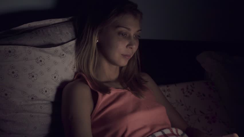 Young woman using laptop in bed at night | Shutterstock HD Video #1008236554