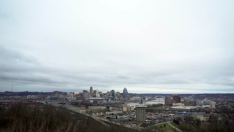 The Cincinnati skyline on a cloudy, overcast shot from Devou Park. Composed with negative space on top for text.