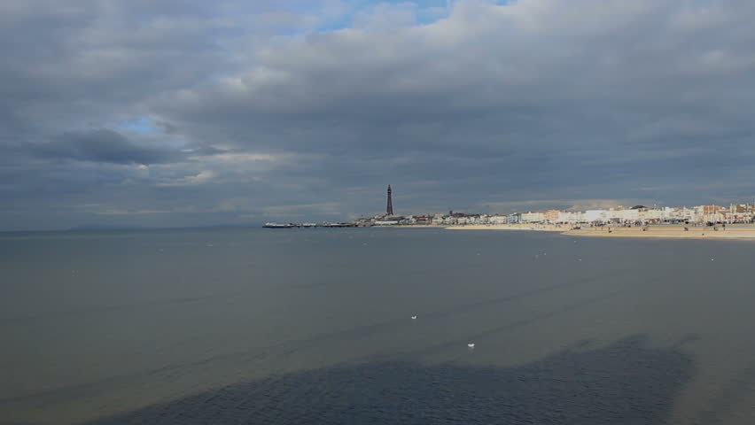 Postcard of the Irish Sea, North Pier and Blackpool Tower on a cloudy day filmed from Central Pier