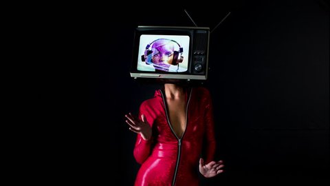 woman dancing and posing with a television as a head. the tv is has a video of a mannequin head (no model release needed) from my own collection on it