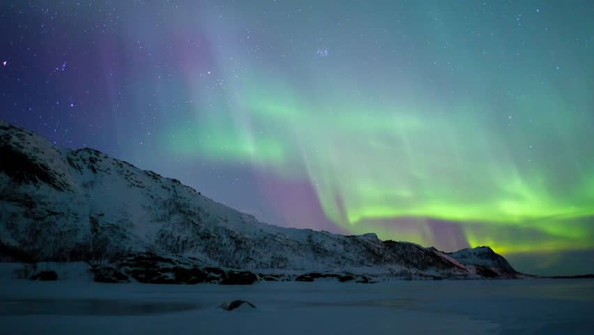 Time lapse clip of Polar Light or Northern Light (Aurora Borealis) in the night sky over the Lofoten islands in Northern Norway in winter. | Shutterstock HD Video #1008336694